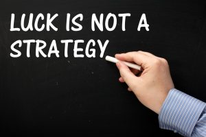 Luck Is Not A Strategy reminder on a blackboard